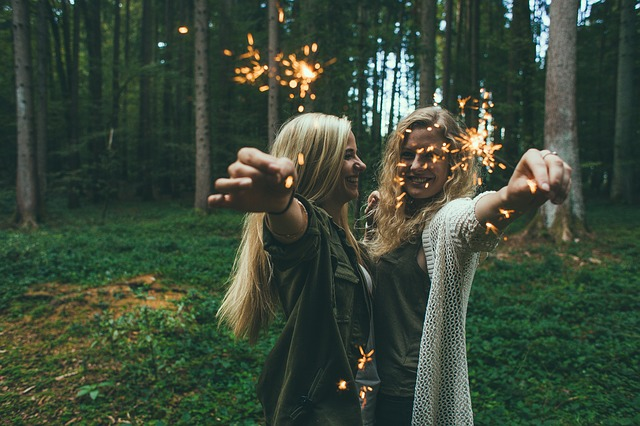 Two girls holding firework sparklers