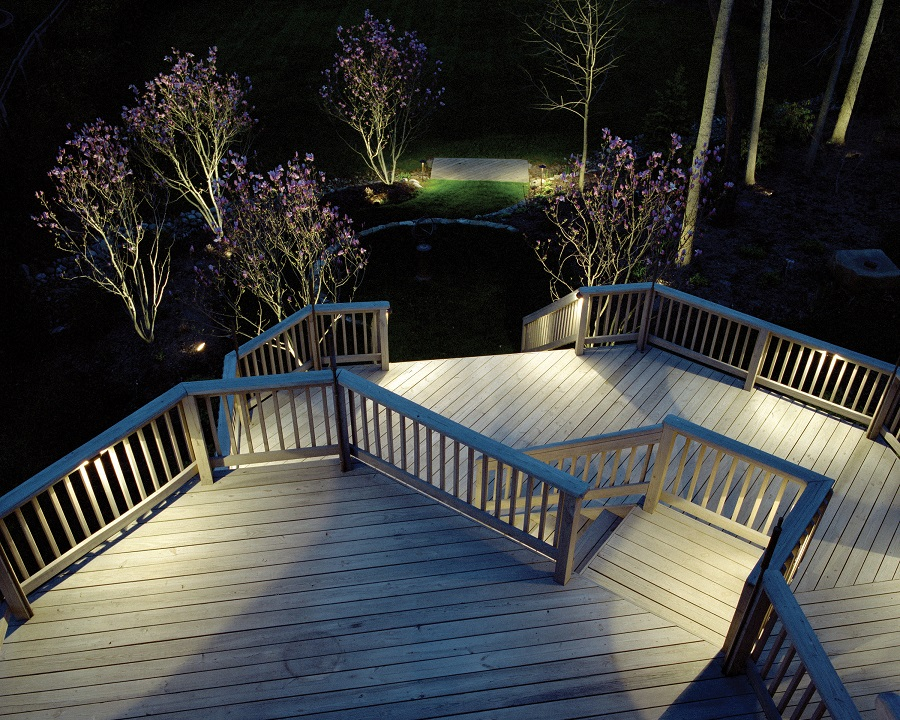 Large deck with railing, stairs and lighting