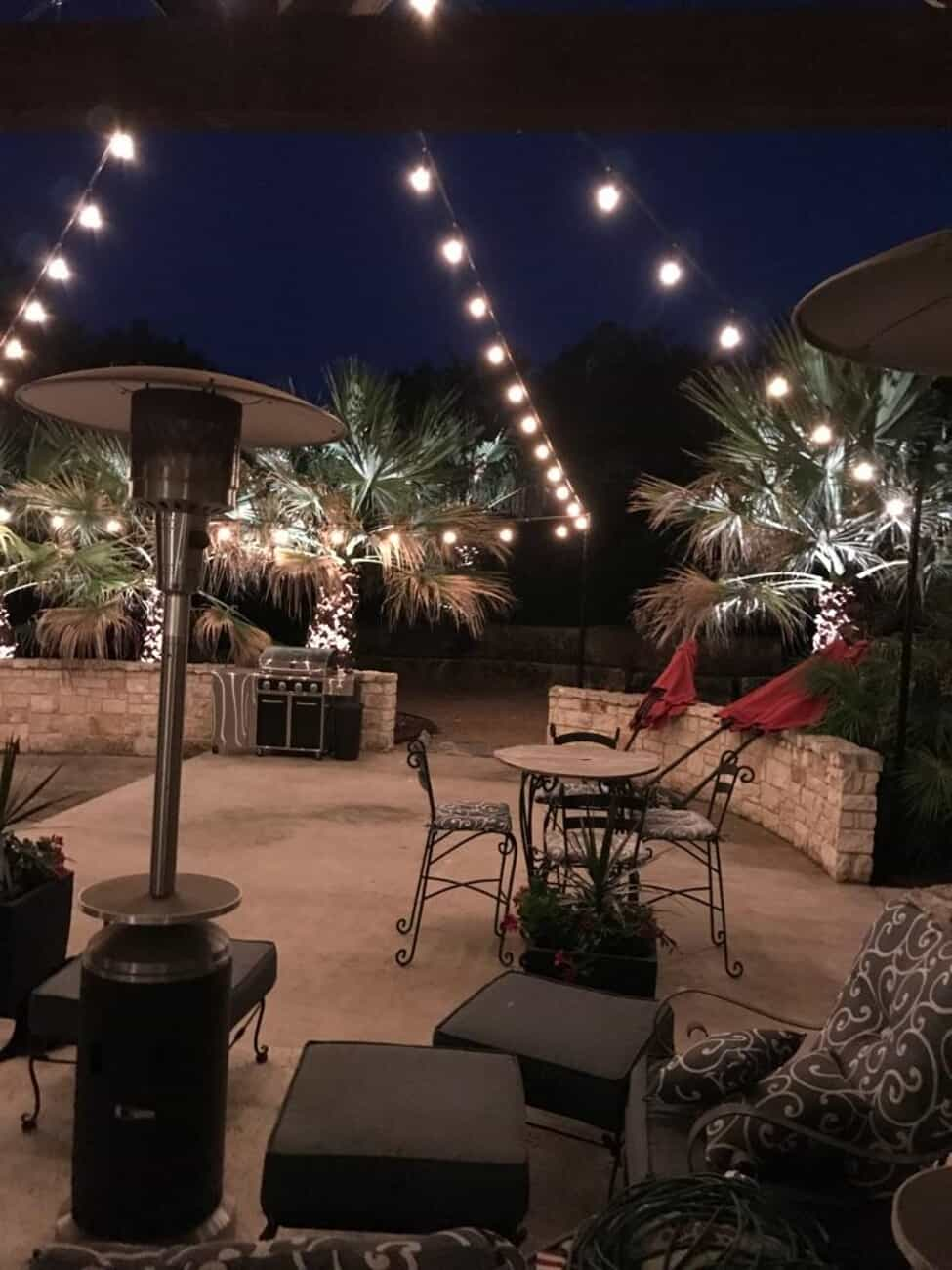 residential back yard with string lighting