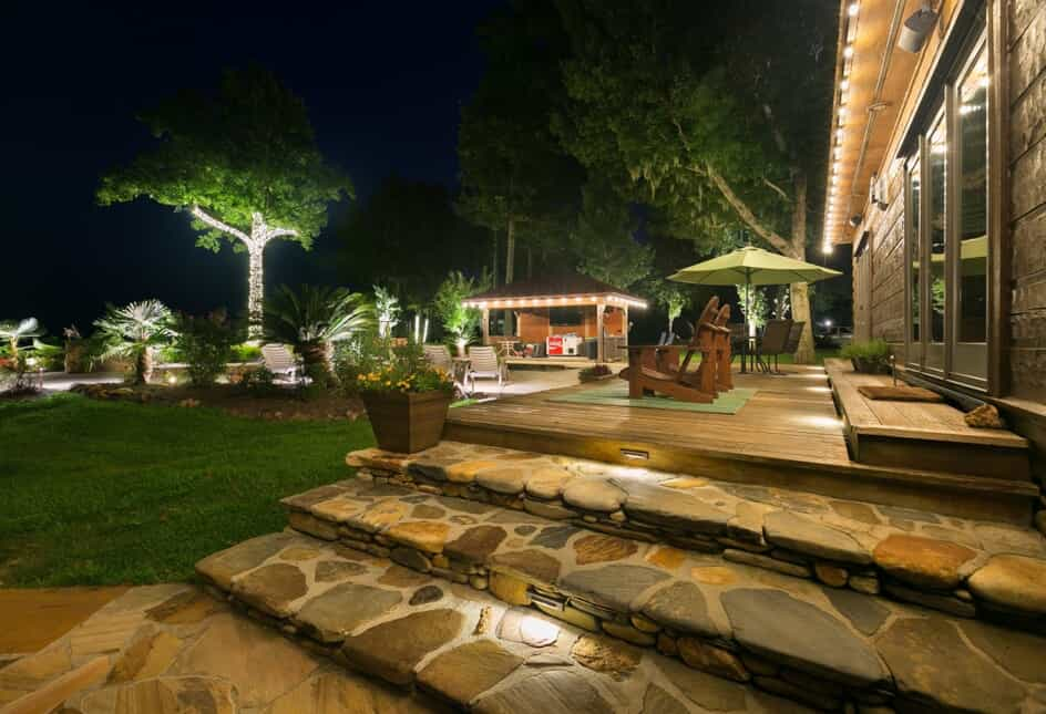 residential custom back yard with lighting