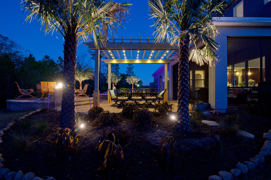 Outdoor patio and landscape lighting in Jacksonville backyard