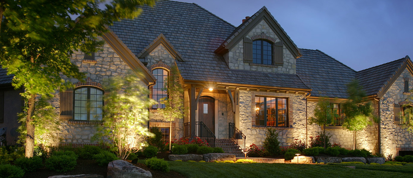 front of a Germantown house lit with outdoor lighting