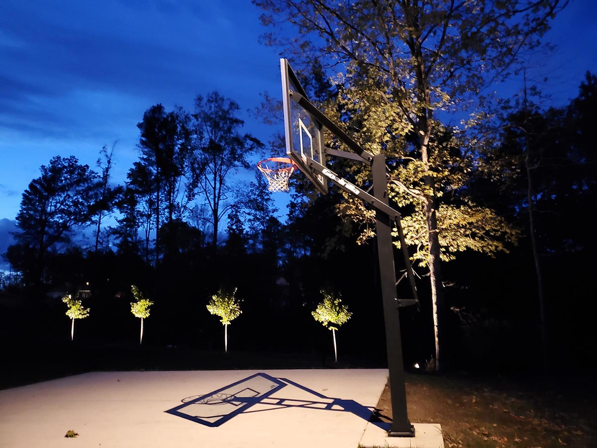 back yard lighting and basketball court illumination for a home