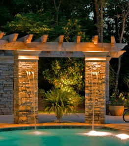 Two brick pillars by the pool side