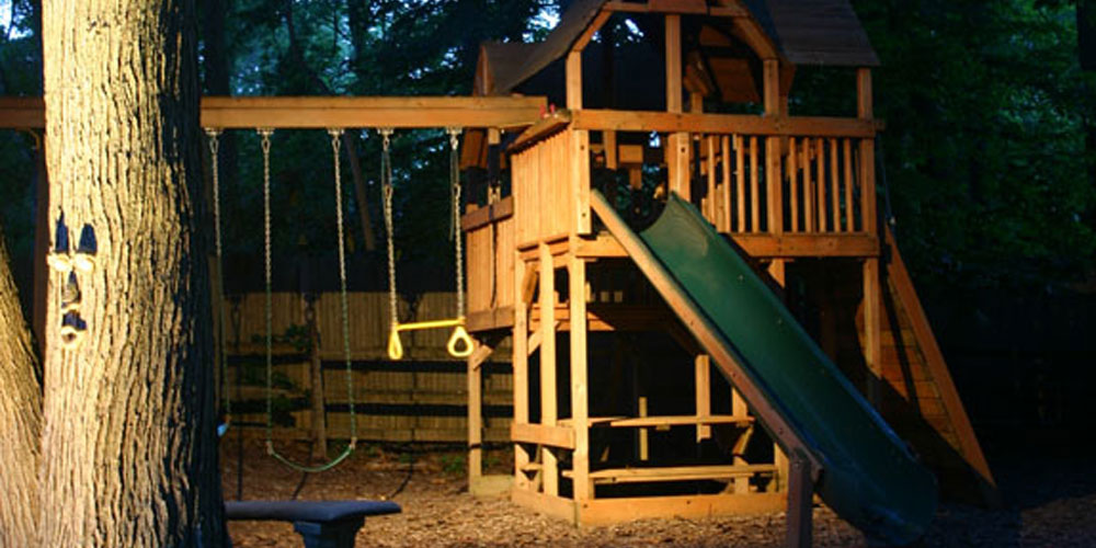 Outdoor child's play area with moonlighting