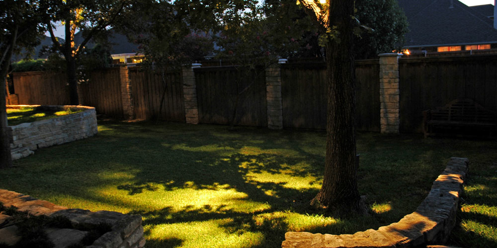 Residential yard with landscape lighting