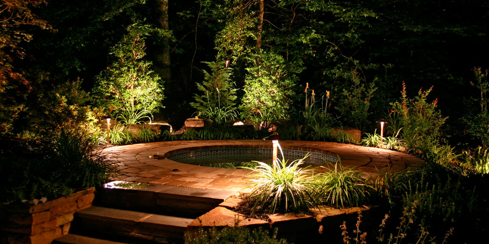 Outdoor hot tub with landscape lighting