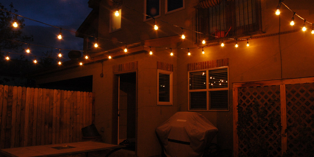 Residential outdoor area with string lighting