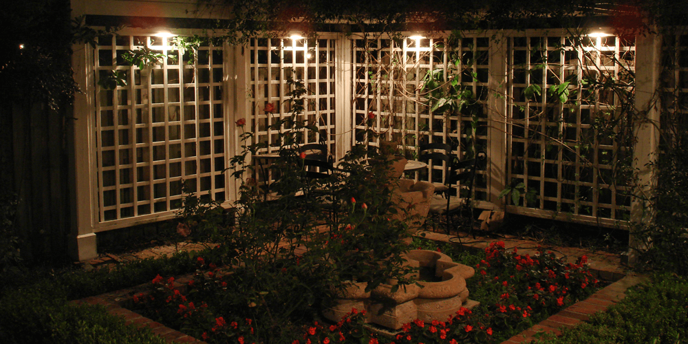 Courtyard with a fountain and rose bushes