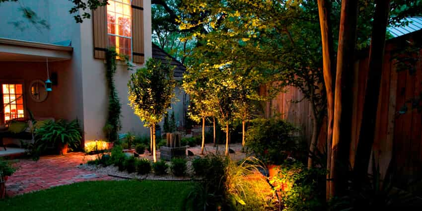 Backyard patio with landscape lighting