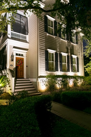 Front of home with trees and landscape lighting